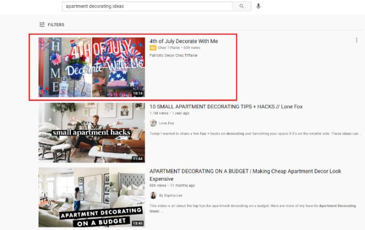 A YouTube search results page displaying a YouTube discovery ad.